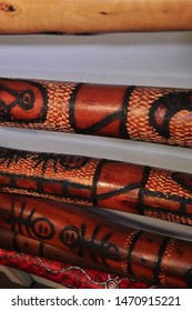 Australian handmade didgeridoo instruments with native paintings art, aborigine craft shop