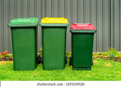 Australian home rubbish bins set provided by local council on back yard in Australian suburb
