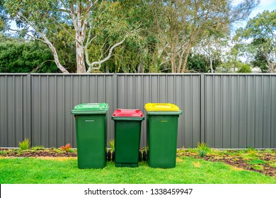Australian home waste bins set provided by local council installed on backyard of suburbuan house