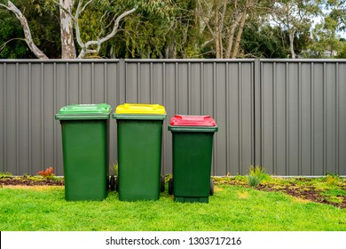 Australian home wheelie bins set provided by local council on back yard
