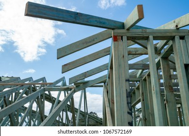 Australian house construction timber frame and blue sky with clouds