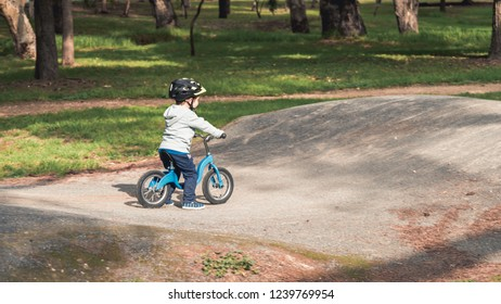 Australian kid riding his balance bike in the park, South Australia