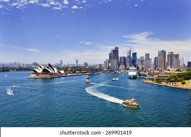 australian major landmarks in Sydney - cityscape of city CBD view from Harbour Bridge across harbour waters on a sunny summer day
