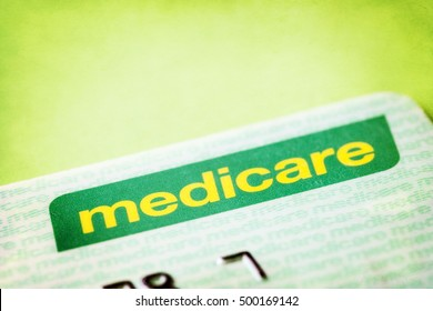 Australian Medicare card over textured background.