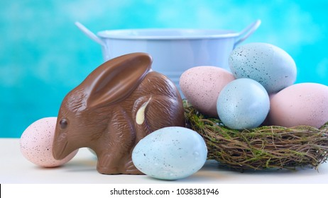 Australian milk chocolate Bilby Easter egg with eggs in nest against a blue and white background