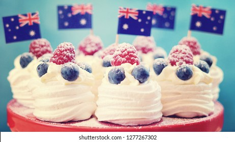 Australian mini pavlovas and flags in red, white and blue for Australia Day or national holiday party food treats, with applied vintage wash filter.