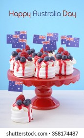 Australian mini pavlovas and flags in red, white and blue for Australia Day or national holiday party food treats, and sample text.