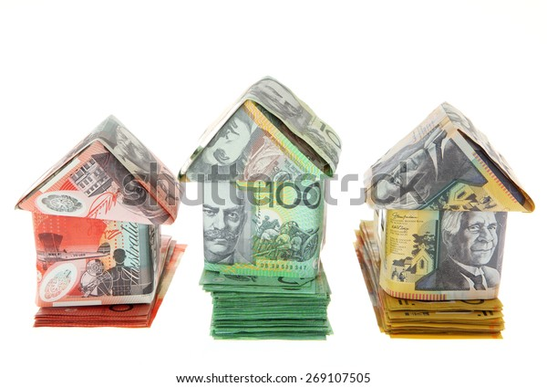 Australian Money - Aussie currency houses on stacks of money - first second and third