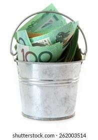 Australian Money - Aussie currency in a tin bucket