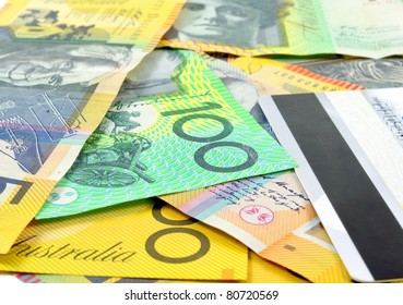 australian money with credit card as a background