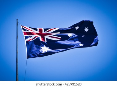 Australian National Flag blowing in the wind showing southern cross and union jack.