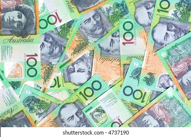 Australian one hundred dollar notes make a full-frame background.
