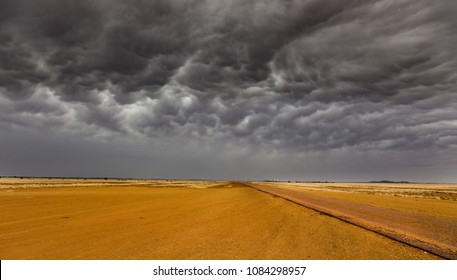 Australian outback colours Queensland Birdsville vicinity with impending storm