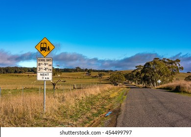 Australian outback road with school bus stop sign. Unmarked rural path. Myrtleville NSW, Australia