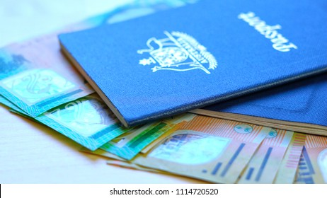 Australian passport and cash travel concept closeup macro shot, with hundred and fifty dollar bills, shallow DOF.