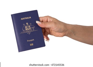 Australian Passport in hand isolated in white background.