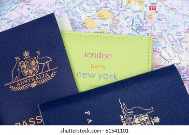 australian passport and holder on top of paris map