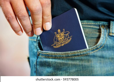Australian passport in mans jeans pocket, close up.