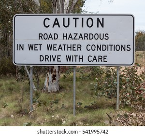 Australian Road Sign on unsealed dirt roads that the road ahead is hazardous in wet weather and to drive with care