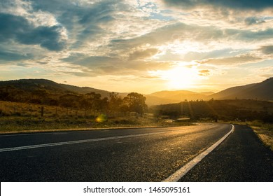 Australian snowy mountains region - sunset over road