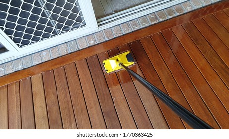 Australian spotted gum deck being stained for the first time - Shutterstock ID 1770363425
