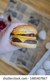 an Australian style burger with beetroot slices, pineapple, and egg on it