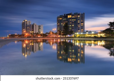 Australian suburb in front of water at night (Gold Coast, Labrador, QLD, Australia)