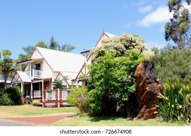 Australian suburban street, row of detached wooden townhouses with porch and front yard gardens, Western Australia