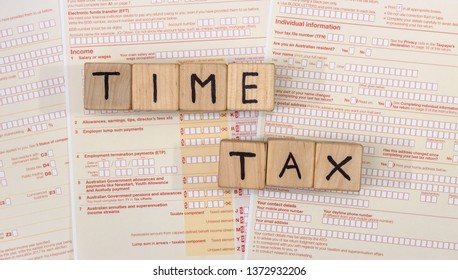 Australian tax form with wooden cubes on it