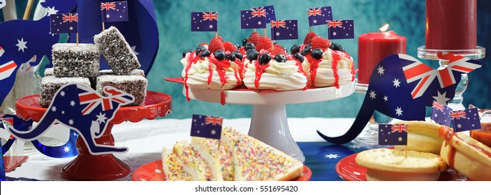 Australian theme party table with flags and iconic food including mini pavlovas, lamingtons, meat pies and fairy bread, sized to fit a popular social media cover image placeholder.