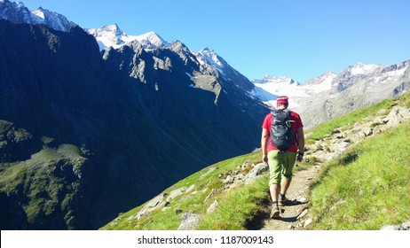 "Austria. Alpine region ""Stubai"". The Oberbergtal Valley. Climber on a mountain path."