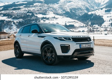 AUSTRIA, ALPS - MARCH 25, 2018: Latest brand new white 2018 Range Rover Evoque. Beautiful car SUV in the nature deep in Alps. Range Rover bestselling model in the wild.