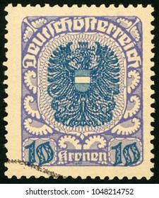 AUSTRIA - CIRCA 1921: stamp printed in Deutsch Osterreich shows coat of arms; Scott 247 A48 10k blue purple, circa 1921