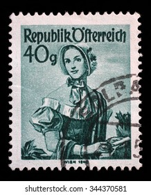 """AUSTRIA - CIRCA 1948: A stamp printed in Austria from the """"Provincial Costumes"""" issue shows a woman from Vienna (1840), circa 1948."""
