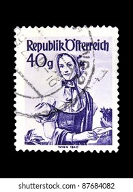 """AUSTRIA - CIRCA 1948: A stamp printed in Austria shows a woman in the Austrian national dress with the inscription """" Vienna, 1840"""" from the series """"Costumes"""", circa 1948"""