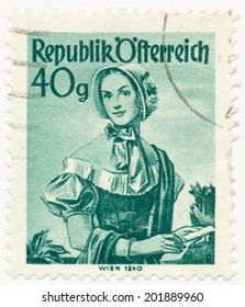 AUSTRIA - CIRCA 1949: A stamp printed in Austria shows image woman in national Austrian costumes, Vienna, 1840, series, circa 1949