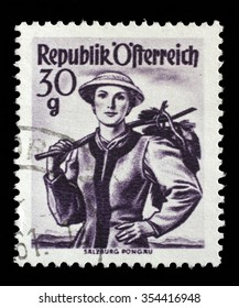 """AUSTRIA - CIRCA 1950: A stamp printed in Austria shows image woman in national Austrian costumes, Salzburg, Pongau , from the series """"Costumes"""", circa 1950"""