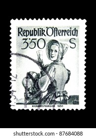 """AUSTRIA - CIRCA 1951: A stamp printed in Austria shows a woman in the Austrian national dress with the inscription """"Lower Austria, 1850"""" from the series """"Costumes"""", circa 1951"""