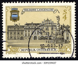 AUSTRIA - CIRCA 1982: A stamp printed in Austria, shows Main square of Langenlois & city coat of arms, circa 1982