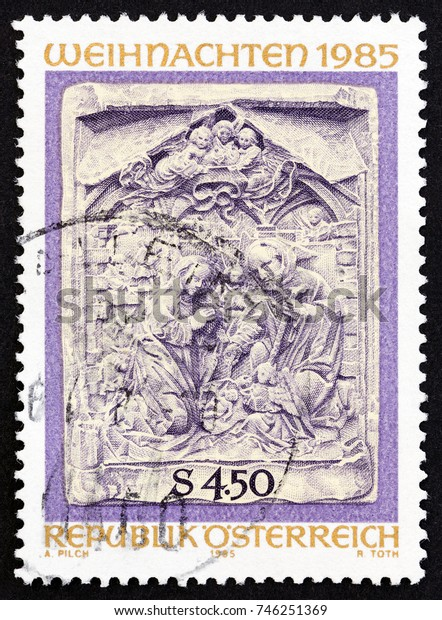 """AUSTRIA - CIRCA 1985: A stamp printed in Austria from the """"Christmas"""" issue shows Adoration of the Christ Child (marble relief), circa 1985."""