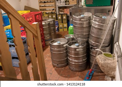 AUSTRIA, DEC 22 2018, The depot of pub with barrels of beer. Beverage storage in the basement cellar. Storage of casks with beer and crates with bottles for restaurant.