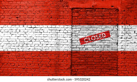 Austria flag on brick wall with bricked door and Closed sign