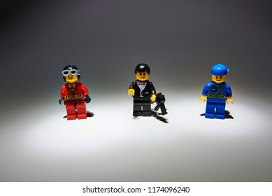 Austria, Innsbruck, September 07, 2018. Lego minifigures in Uniform are manufactured by The Lego Group with shadow on white.