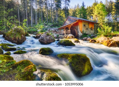 Austria landscape with waterfall and watermill near Salzburg, Golling Alps