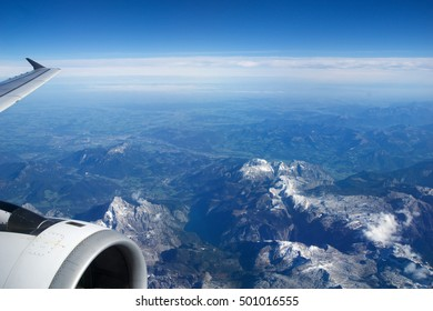 AUSTRIA - October 2016: The alps as seen from an airplane, wing view with plane turbine or engine