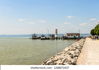 Austria, Podersdorf - 07.06.2015: The famous Lighthouse of Podersdorf,Lake Neusiedl,Burgenland, Tourists walking on pier