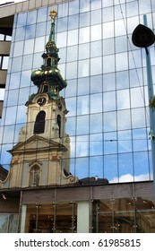 "Austria. The reflection view of church ""Stiftskirche"" in Vienna"