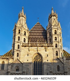 Austria. Vienna. Gothic spires and a fragment of the facade of St. Stephen's Cathedral in the sunset light (Stephansdom)