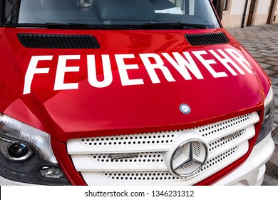 Austria, Vienna, Hofburg Palace: Front view of red white Daimler Mercedes Benz Sprinter fire engine truck in the city center of the Austrian capital - concept public service help. February 01, 2019