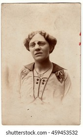 AUSTRIA-HUNGARY - CIRCA 1917: Vintage photo shows a mature woman wears vintage antique nose clip glasses. Retro black & white photography. Photo was taken in Austro-Hungarian Empire.